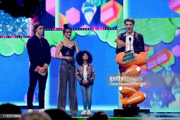 Joel Courtney and Paris Berelc present Jace Norman with the Favorite Male TV Star for 'Henry Danger' onstage at Nickelodeon's 2019 Kids' Choice...