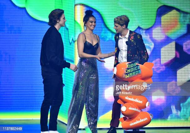 Joel Courtney and Paris Berelc present the award for Favorite Male TV Star award for 'Henry Danger ' to Jace Norman onstage at Nickelodeon's 2019...