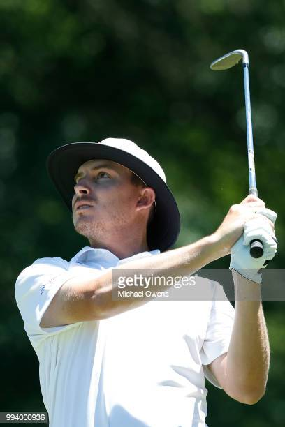 Joel Dahmen hits his second shot on the first hole during the final round of A Military Tribute At The Greenbrier held at the Old White TPC course on...