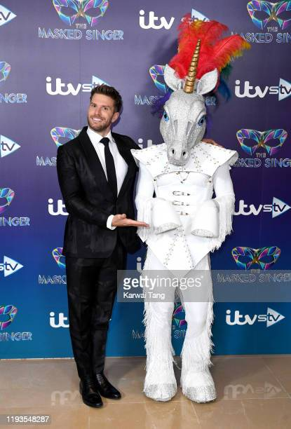 Joel Dommett attends The Masked Singer photocall at The Mayfair Hotel on December 12 2019 in London England