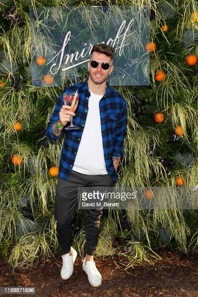 Joel Dommett attends the Smirnoff Infusions Pick Your Own launch party at the Nomadic Community Gardens on July 03 2019 in London England