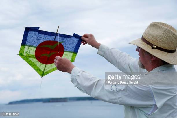 Joel Eckhaus shows a Brazilian pipa kite that will be part of an exhbit at Mayo Street arts in the summer The kite is made with bamboo and tissue and...