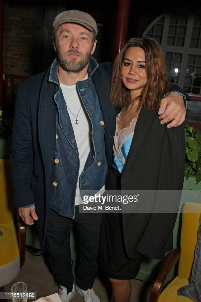 Joel Edgerton and Christine Centenera attend the Victoria Beckham x YouTube Fashion Beauty after party at London Fashion Week hosted by Derek...