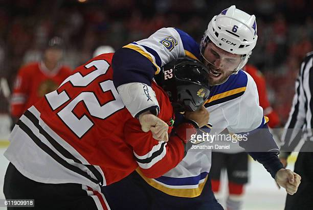 Joel Edmundson of the St Louis Blues and Jordin Tootoo of the Chicago Blackhawks fight in the second period during a preseason game at the United...