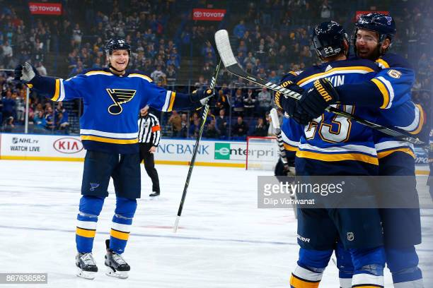 Joel Edmundson of the St Louis Blues celebrates his goal against the Columbus Blue Jackets with Colton Parayko and Dmitrij Jaskin of the St Louis...