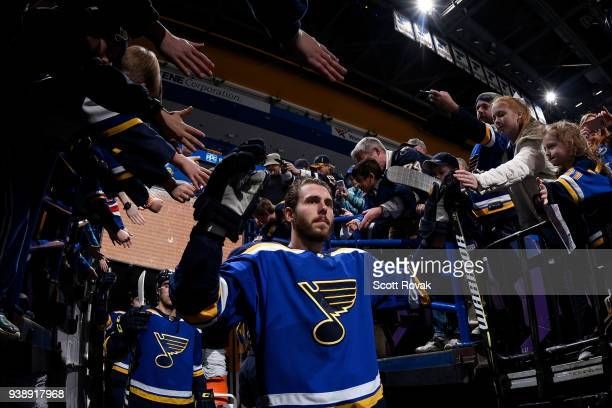Joel Edmundson of the St Louis Blues greets fans before taking the ice for warmups against the San Jose Sharks at Scottrade Center on March 27 2018...