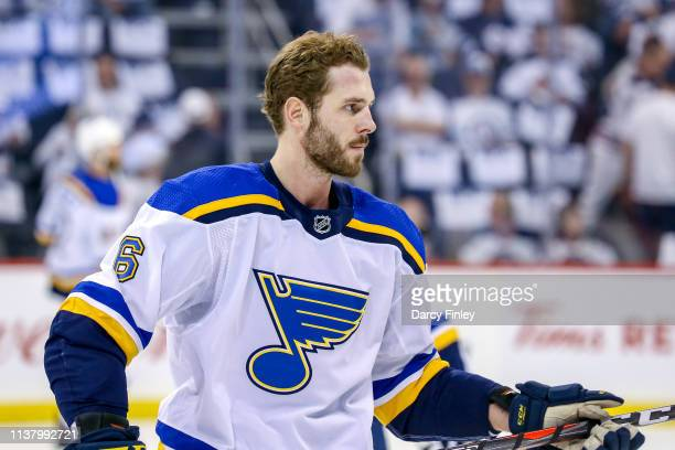Joel Edmundson of the St Louis Blues takes part in the pregame warm up prior to NHL action against the Winnipeg Jets in Game Five of the Western...