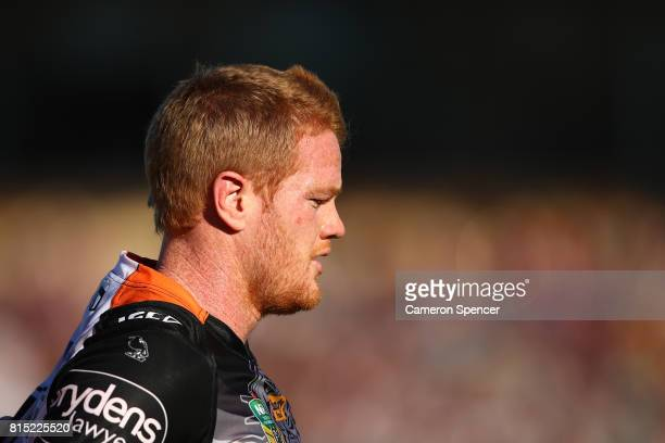 Joel Edwards of the Tigers leaves the field during the round 19 NRL match between the Manly Sea Eagles and the Wests Tigers at Lottoland on July 16...