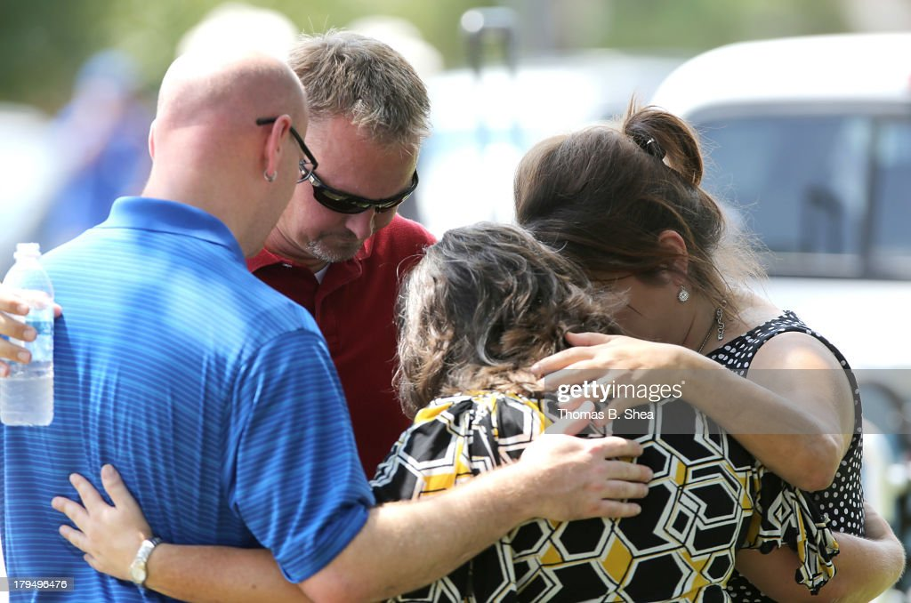 Joel Eisenbruse, John Cordey , Rosemary Alyea and Michelle Cress, with the Trinity Church outreach, pray at the scene of a stabbing at Spring High School September 4, 2013 in Spring, Texas. A 17-year-old student was fatally stabbed and three other students during what has been reported as a fight at the school about 7:00 am. Three people have been taken into custody.