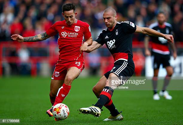 Joel Ekstrand of Bristol City battles for the ball with Pajtim Kasami of Nottingham Forest during the Sky Bet Championship match between Bristol City...