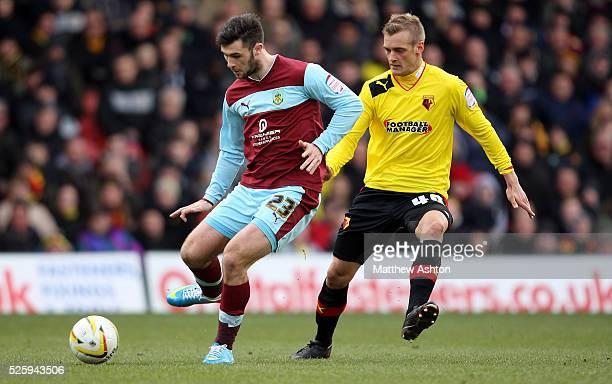 Joel Ekstrand of Watford and Charlie Austin of Burnley battle for the ball