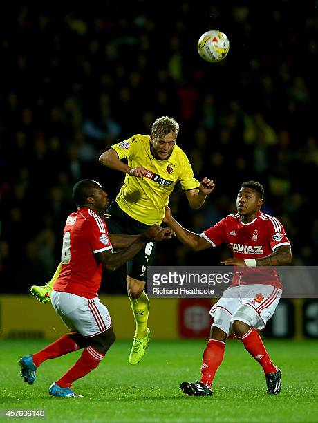 Joel Ekstrand of Watford heads clear under pressure from Michail Antonio and Britt Assombalonga of Forest during the Sky Bet Championship match...