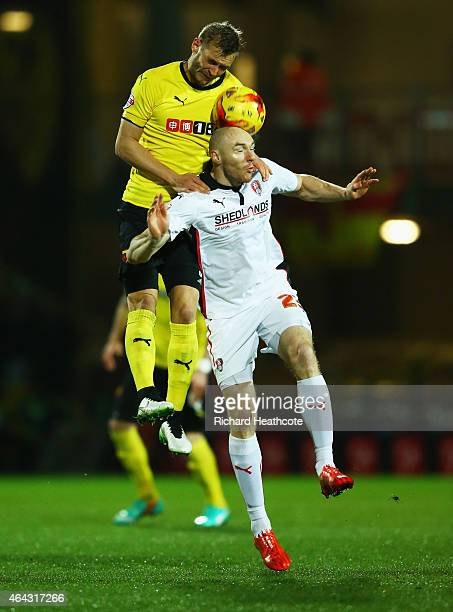 Joel Ekstrand of Watford outjumps Conor Sammon of Rotherham United during the Sky Bet Championship match between Watford and Rotherham United at...