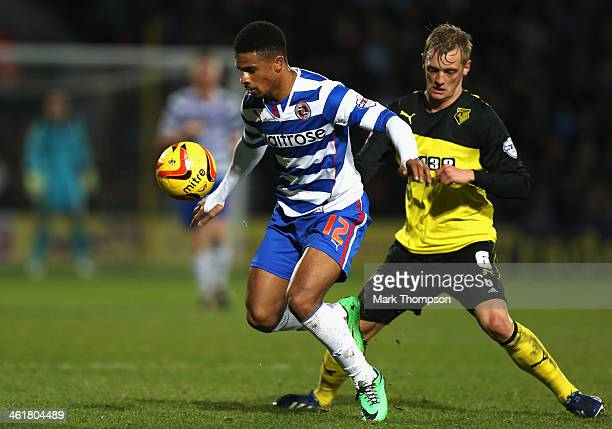 Joel Ekstrand of Watford tangles with Garath McCleary of Reading during the Sky Bet Championship match between Watford and Reading at Vicarage Road...