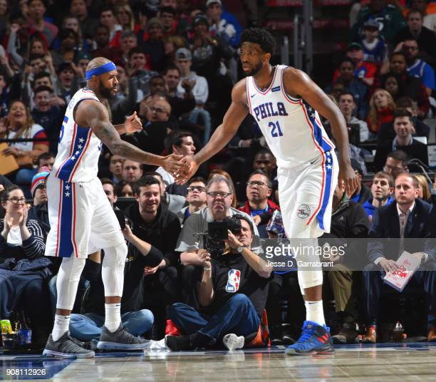 Joel Embiid and Amir Johnson of the Philadelphia 76ers shake hands against the Milwaukee Bucks at Wells Fargo Center on January 20 2018 in...