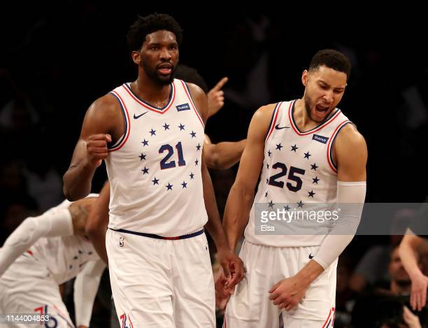 Joel Embiid and Ben Simmons of the Philadelphia 76ers celebrate the win over the Brooklyn Nets at Barclays Center on April 20 2019 in the Brooklyn...