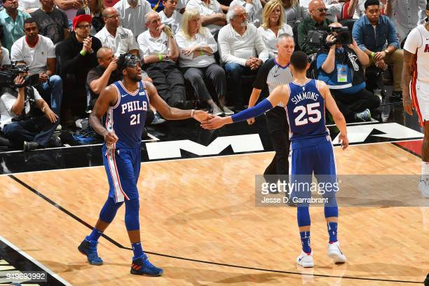 Joel Embiid and Ben Simmons of the Philadelphia 76ers high five during the game against the Miami Heat in Game Four of Round One of the 2018 NBA...