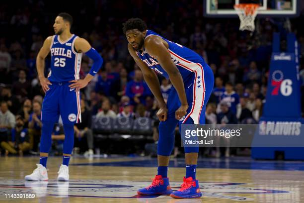 Joel Embiid and Ben Simmons of the Philadelphia 76ers look on against the Brooklyn Nets in Game Two of Round One of the 2019 NBA Playoffs at the...