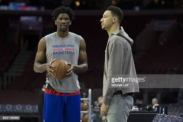 Joel Embiid and Ben Simmons of the Philadelphia 76ers look on prior to the game against the Sacramento Kings at the Wells Fargo Center on January 30...