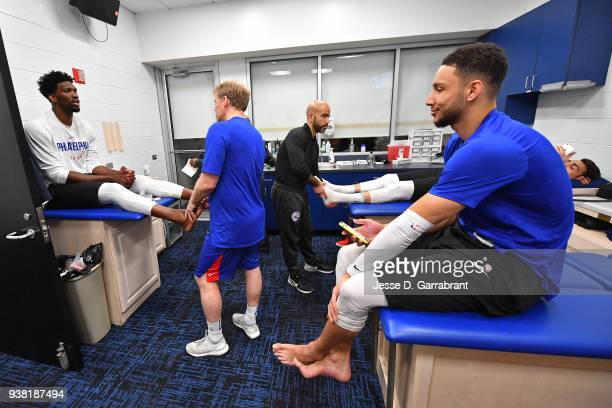 Joel Embiid and Ben Simmons of the Philadelphia 76ers talk while getting treatment in the locker room before the game against the Minnesota...