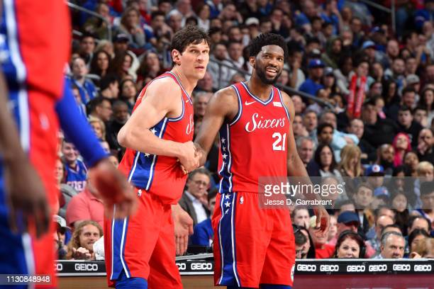 Joel Embiid and Boban Marjanovic of the Philadelphia 76ers highfive during a game against the Sacramento Kings on March 15 2019 at the Wells Fargo...