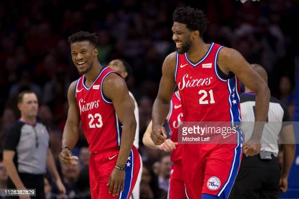 Joel Embiid and Jimmy Butler of the Philadelphia 76ers react against the Denver Nuggets at the Wells Fargo Center on February 8 2019 in Philadelphia...