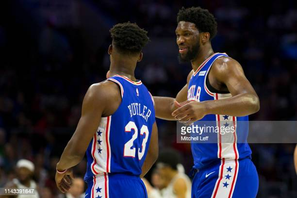 Joel Embiid and Jimmy Butler of the Philadelphia 76ers react against the Brooklyn Nets in Game Two of Round One of the 2019 NBA Playoffs at the Wells...