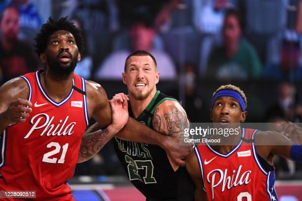 Joel Embiid and Josh Richardson of the Philadelphia 76ers fight for position against Daniel Theis of the Boston Celtics during Round One, Game One of...