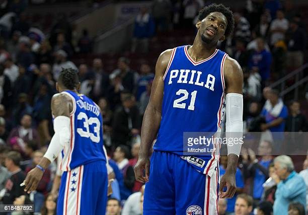 Joel Embiid and Robert Covington of the Philadelphia 76ers react in the final moments of the game against the Oklahoma City Thunder at Wells Fargo...