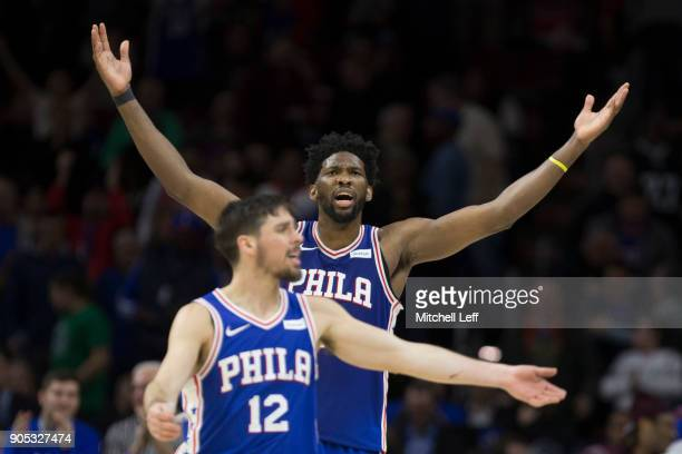 Joel Embiid and TJ McConnell of the Philadelphia 76ers react in the fourth quarter against the Toronto Raptors at the Wells Fargo Center on January...