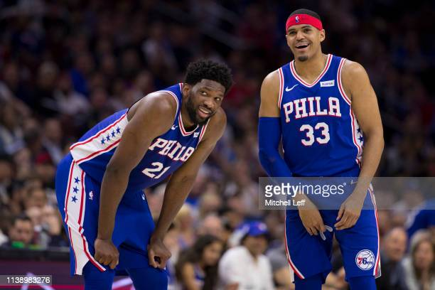 Joel Embiid and Tobias Harris of the Philadelphia 76ers share a laugh against the Brooklyn Nets in the second quarter of Game Five of Round One of...