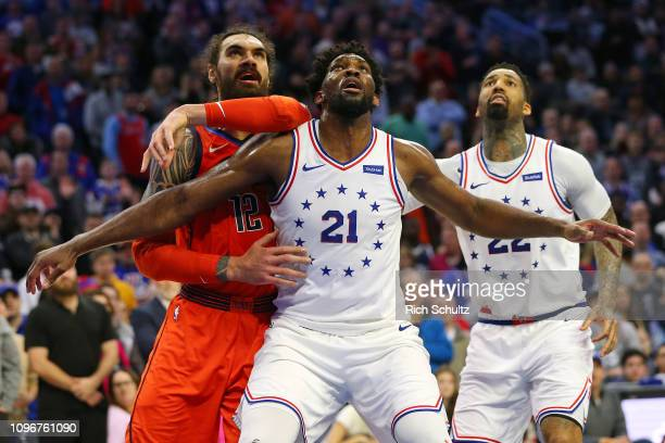 Joel Embiid and Wilson Chandler of the Philadelphia 76ers in action against Steven Adams of the Oklahoma City Thunder during a game at Wells Fargo...