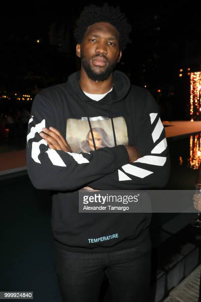 Joel Embiid attends the 2018 Sports Illustrated Swimsuit show at PARAISO during Miami Swim Week at The W Hotel South Beach on July 15 2018 in Miami...