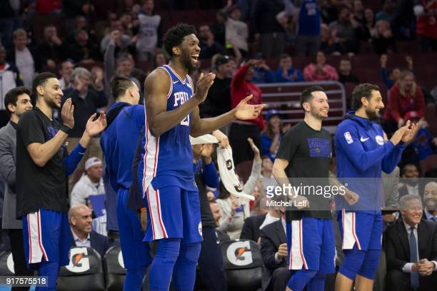 Joel Embiid Ben Simmons JJ Redick and Marco Belinelli of the Philadelphia 76ers celebrate from the bench in the fourth quarter after TJ McConnell...