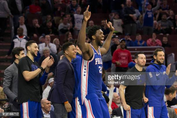 Joel Embiid Ben Simmons Markelle Fultz JJ Redick and Marco Belinelli of the Philadelphia 76ers celebrate from the bench in the fourth quarter after...