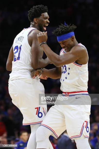 Joel Embiid celebrates with Jimmy Butler of the Philadelphia 76ers after Butler's basket to put the Sixers up by two with 69 seconds left in the game...