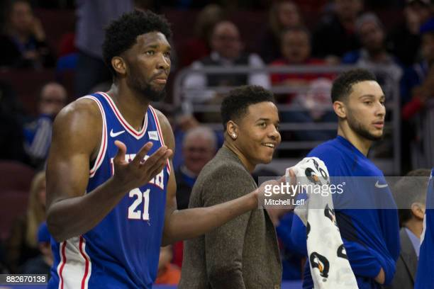 Joel Embiid Markelle Fultz and Ben Simmons of the Philadelphia 76ers react from the bench against the Portland Trail Blazers at the Wells Fargo...