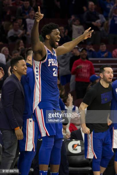 Joel Embiid Markelle Fultz and JJ Redick of the Philadelphia 76ers celebrate from the bench in the fourth quarter after TJ McConnell recorded a...