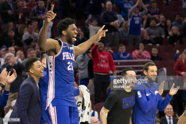 Joel Embiid Markelle Fultz JJ Redick and Marco Belinelli of the Philadelphia 76ers celebrate from the bench in the fourth quarter after TJ McConnell...