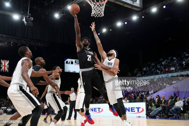 Joel Embiid of Team Africa goes to the basket against Team World during the 2018 NBA Africa Game as part of the Basketball Without Borders Africa on...