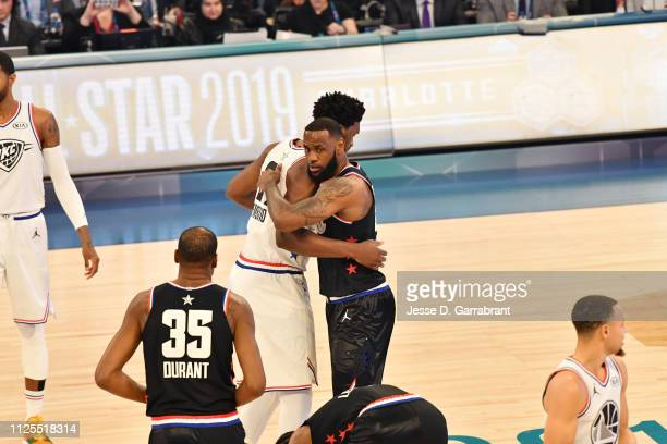 Joel Embiid of Team Giannis and LeBron James of Team LeBron hug prior to the 2019 NBA All Star Game on February 17 2019 at Spectrum Center in...
