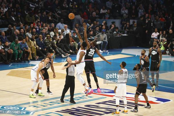 Joel Embiid of Team Giannis goes up for the jump ball against Kevin Durant of Team LeBron during the 2019 NBA AllStar Game on February 17 2019 at the...
