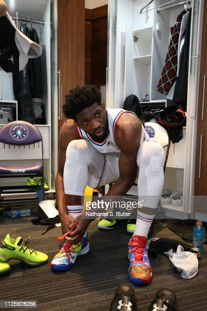 Joel Embiid of Team Giannis is seen lacing his kicks in the locker room before the game against Team LeBron during the 2019 NBA AllStar Game on...
