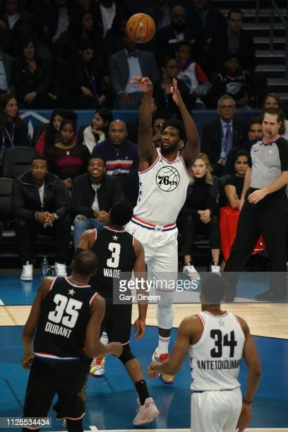 Joel Embiid of Team Giannis shoots against Dwyane Wade of Team LeBron during the 2019 NBA AllStar Game on February 17 2019 at the Spectrum Center in...