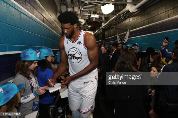 Joel Embiid of Team Giannis signs autographs for fans during the 2019 NBA AllStar Game on February 17 2019 at the Spectrum Center in Charlotte North...