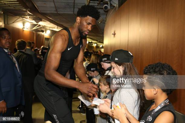 Joel Embiid of team Stephen signs autographs for fans during the NBA AllStar Game as a part of 2018 NBA AllStar Weekend at STAPLES Center on February...