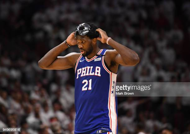 Joel Embiid of the Philadelphia 76ers adjusts his facemark during a break in action in the third quarter against the Miami Heat during Game Four of...