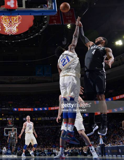 Joel Embiid of the Philadelphia 76ers against Jahlil Okafor of the Brooklyn Nets at the Wells Fargo Center on March 16 2018 in Philadelphia...