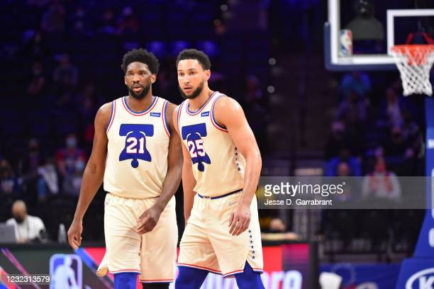 Joel Embiid of the Philadelphia 76ers and Ben Simmons of the Philadelphia 76ers look on during a game against the Brooklyn Nets on April 14, 2021 at...