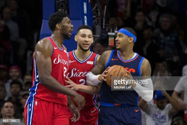 Joel Embiid of the Philadelphia 76ers and Carmelo Anthony of the Oklahoma City Thunder exchange words in front of Ben Simmons of the Philadelphia...